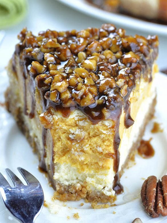 This Sweet Potato Cheesecake with Pecan Topping is delicious combo of traditional Thanksgiving and Christmas desserts: Sweet Potato Pie, Pecan Pie and cheesecake.