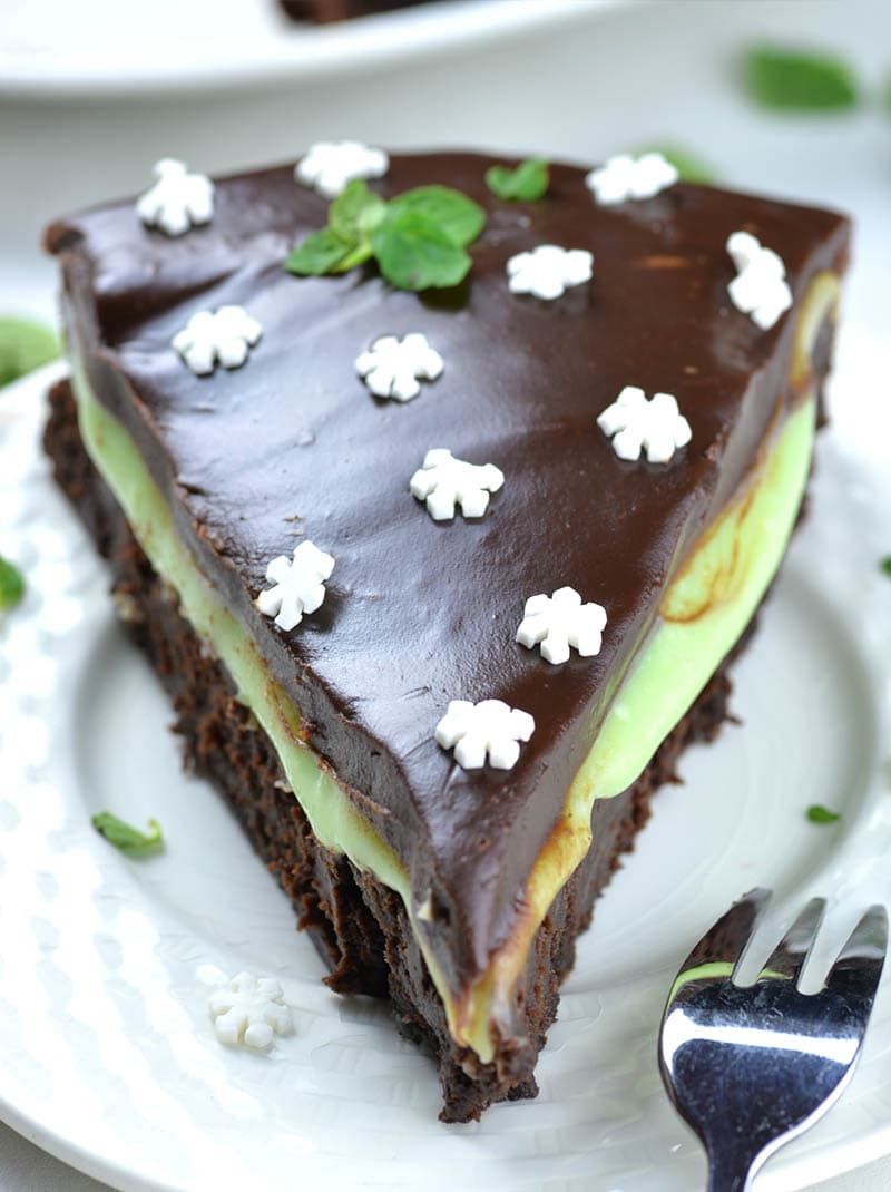 Besides cake and topping, this cake has one more layer of chocolate in the middle. It's silky and creamy white chocolate mint filling.