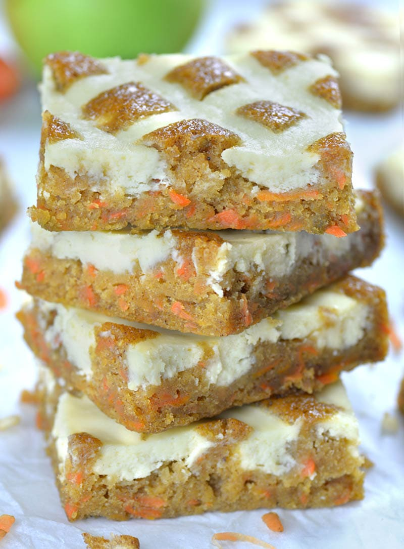 Four Carrot Apple Cheesecake Blondies each on other.