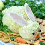 Picture of an Easter bunny shaped cheeseball appetizer.