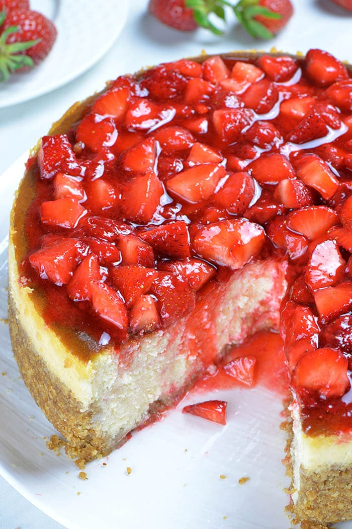 If you love strawberries, too, you won't be able to resist a strawberry sauce that slowly drips down the slice of smooth and creamy cheesecake. #strawberry #cheesecake