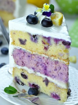 Image of a slice of Lemon Blueberry Cheesecake Cake