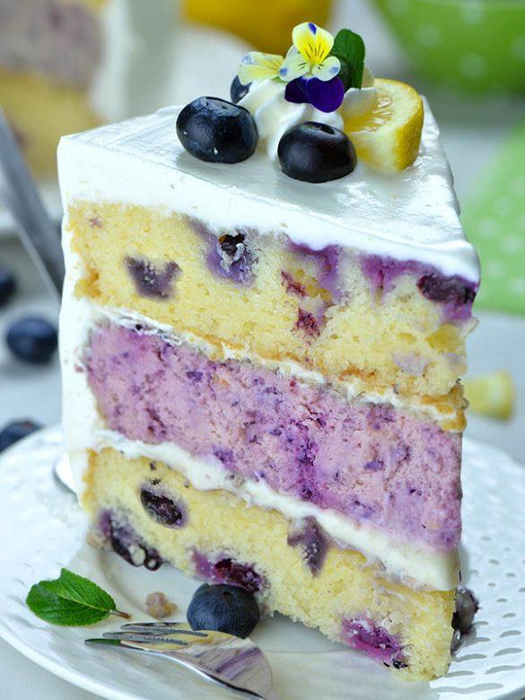 Image of a slice of Lemon Blueberry Cheesecake Cake