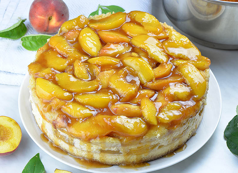 Baked peach cobbler cheesecake with peach topping.