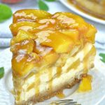 Slice of peach cobbler cheesecake on a plate