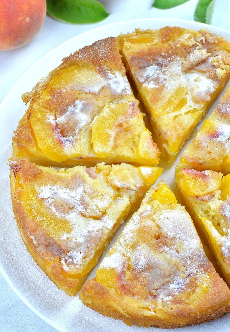 Whole peach cake cut on six pieces.