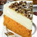 Slice of pumpkin bread cheesecake with pecan praline topping, on a plate