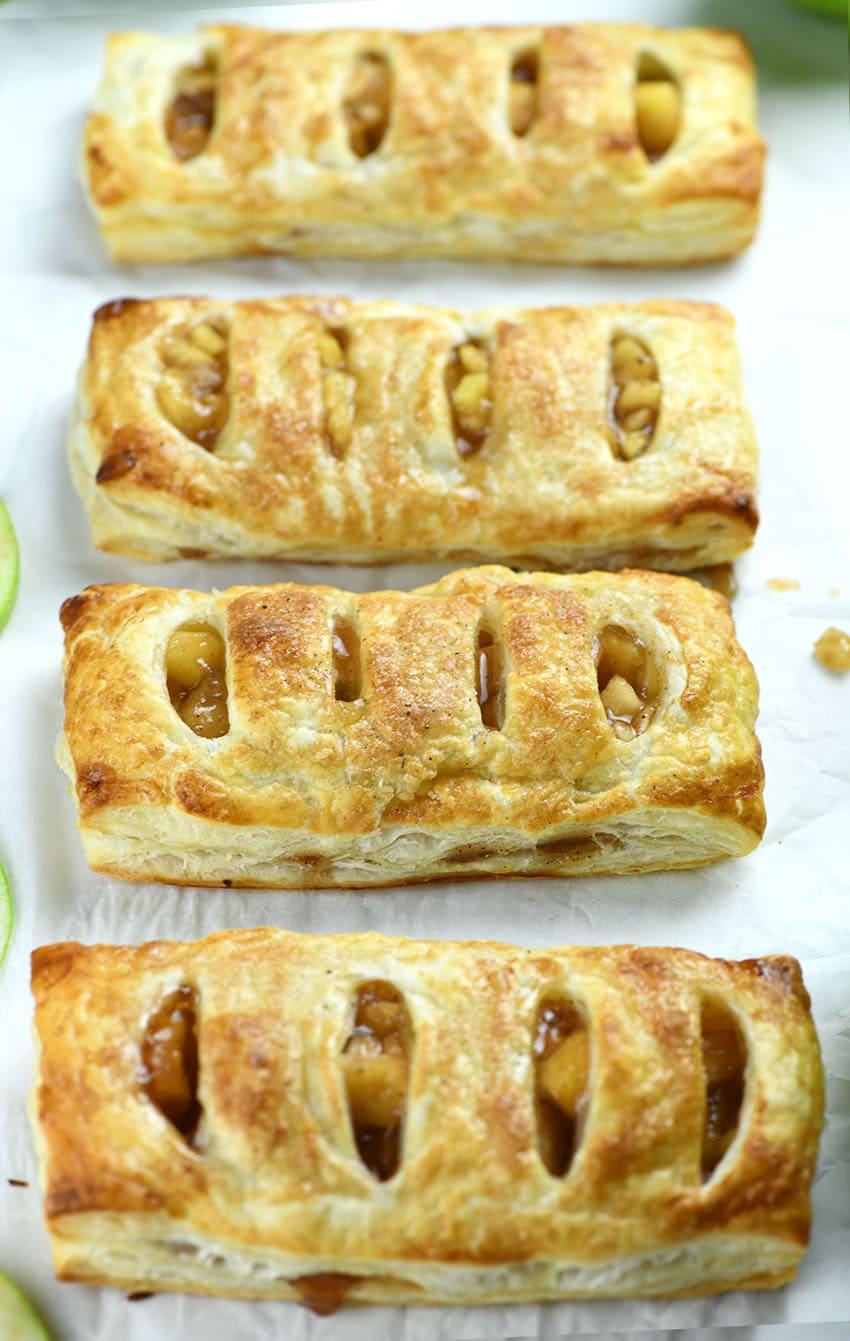 Four pieces of Copycat McDonald's Apple Pies on parchment paper.