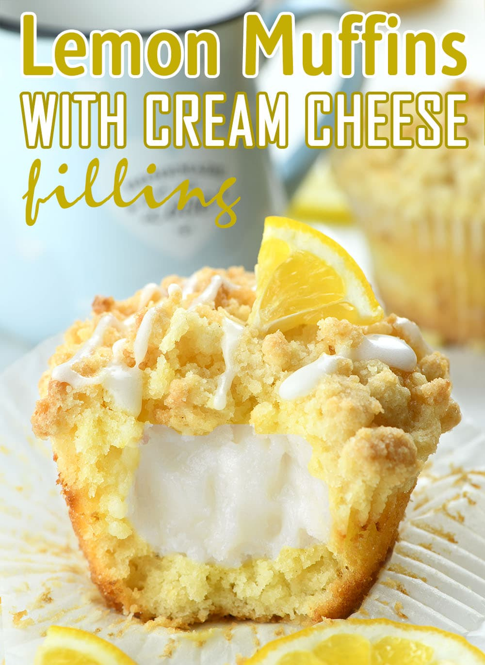 Lemon Cream Cheese Muffin topped with sugar icing , streusel crumbs and lemon on the top.