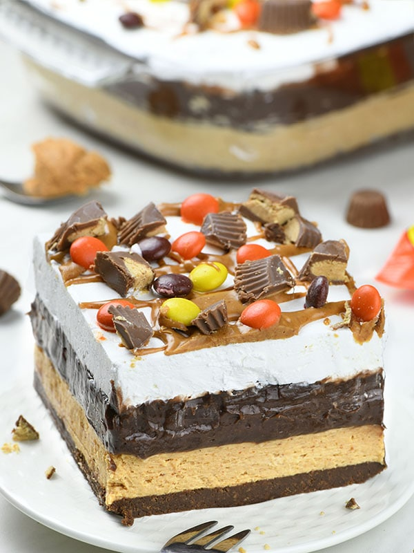 Chocolate Peanut Butter Lasagna on white plate garnished with Reese