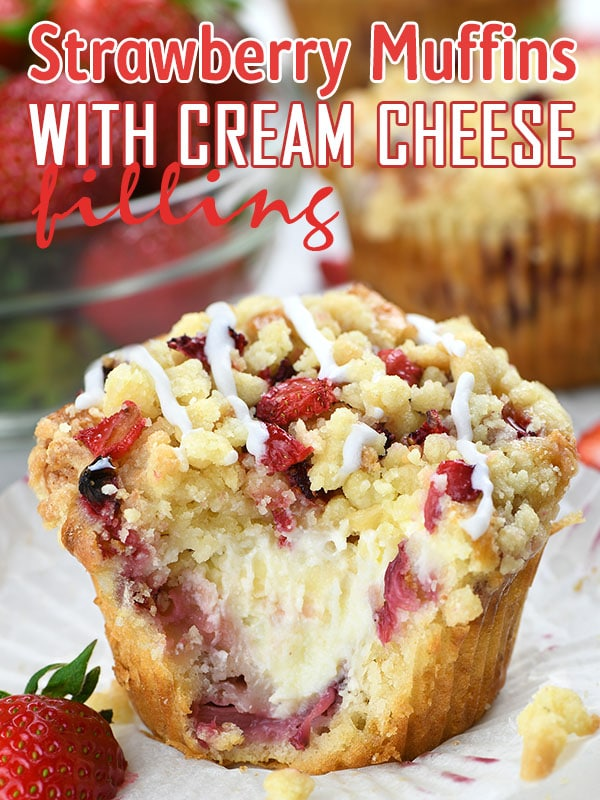 Strawberry Cream Cheese Muffins on a white paper garnished with fresh strawberry.