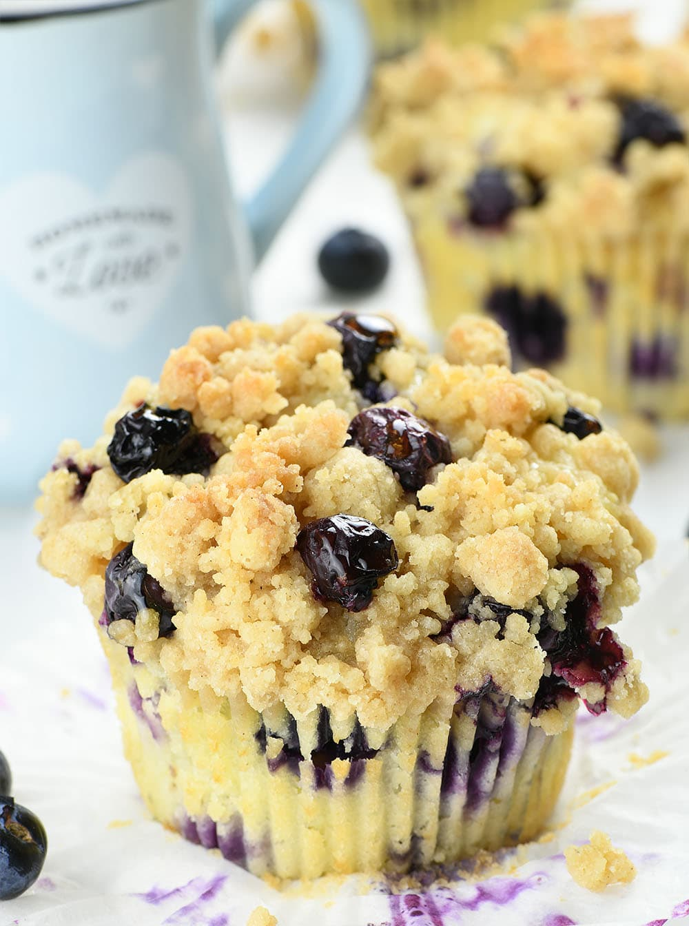 Blueberry Cream Cheese Muffins in front of couple of muffins.