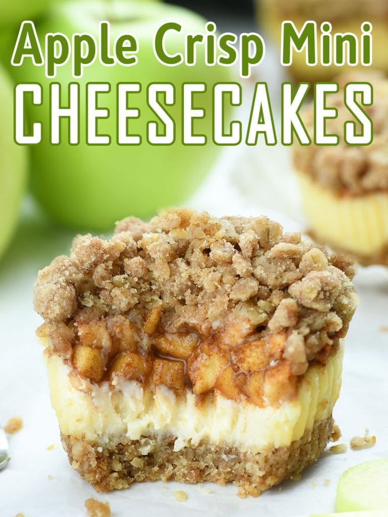 Half of Apple Crisp Mini Cheesecake  with streusel topping and bunch of apples behind.